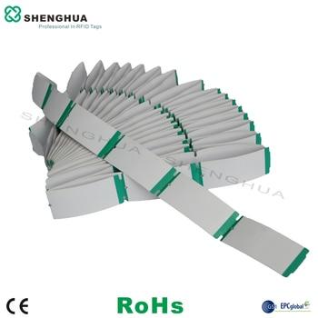 50 unids/pack etiqueta colgante de papel RFID de alta calidad logotipo de marca uhf imprimible Tarjeta de ropa etiqueta de la ropa para la gestión de zapatos sombrero
