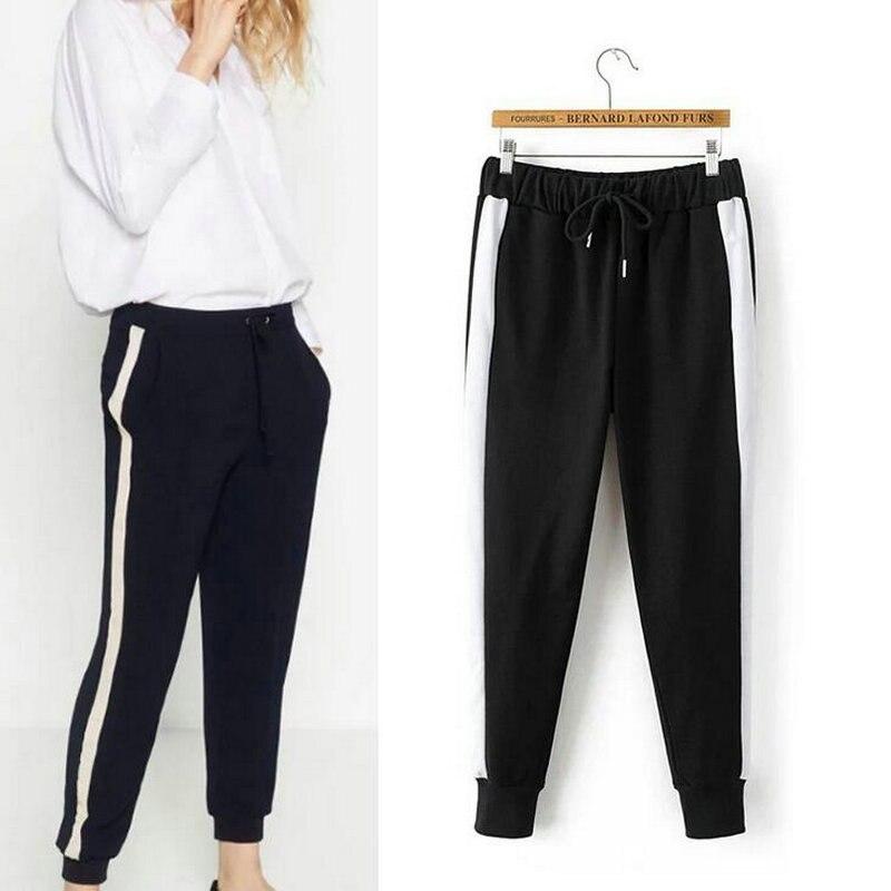 брюки с белой полосой по бокам фото
