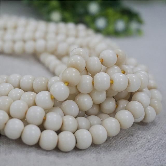 8 mm * 7 mm marfil blanco Natural Tagua granos redondos 108 mala budismo cuentas de madera DIY de la joyería de lujo para hacer Earring & Necklace