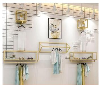 Clothing store display rack wall women's shop wall hanging hangers gold clothing rack side hanging combination.