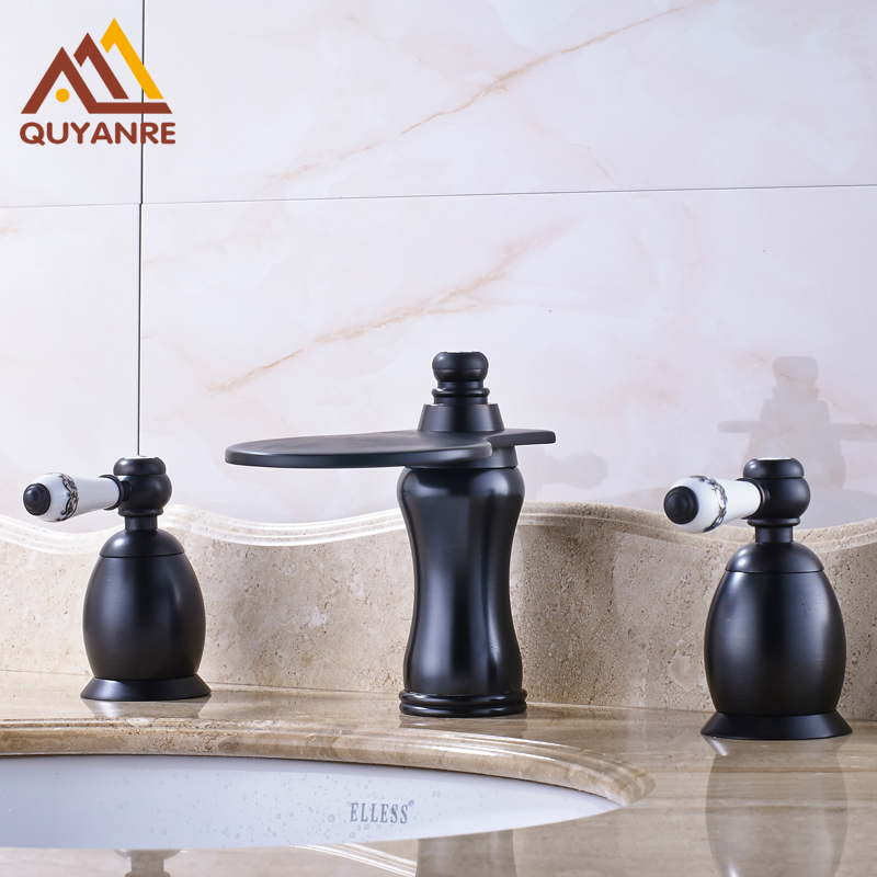 Blackened basin faucets with dual blue and white porcelain - White porcelain bathroom fixtures ...
