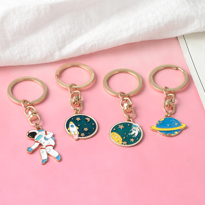 Escape From The Earth ! UFO Space Craft Astronaut Rocket Planet Spaceman Universe Stars Enamel Key Ring KeyChain For Astrophile