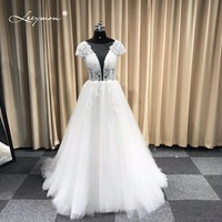 Leeymon 2018 Custom Made Wedding Dress Princess Deep V Neck Sexy Backless White Floor Length Lace