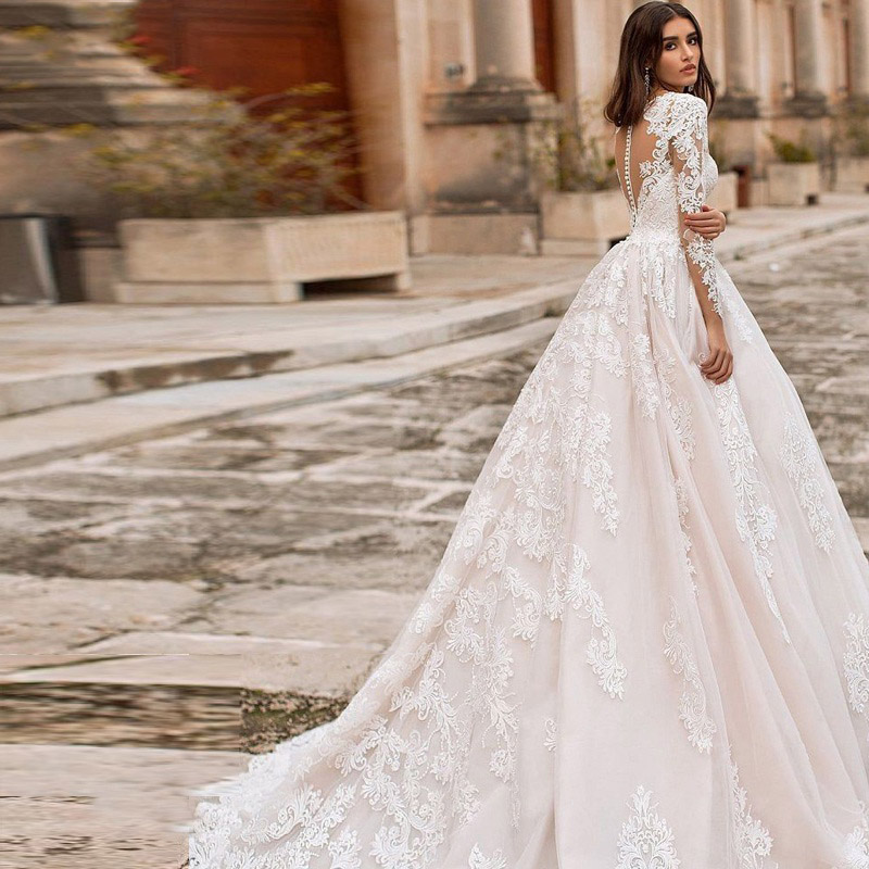 Eightree Vintage V neck A line Wedding Dresses Beach Long Sleeves Bridal De Mariage Elegant Lace Gowns Illusion Back Gowns in Wedding Dresses from Weddings Events