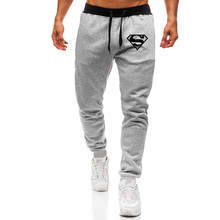 Men's casual sweat pants featuring superman print and color pantaloons