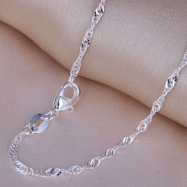Женские цепочки с волнистыми подвесками серебристые застежками