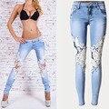 Moda Feminina Lace Emendado Jeans Sexy Oco out branco Lavado Calças Jeans Femininos de cintura Baixa Magro Calças Lápis QL2134