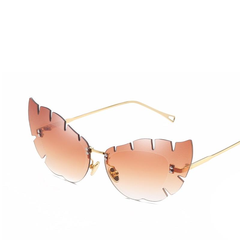 2018 forma de mariposa hojas plumas diseñador vintage gafas de sol - Accesorios para la ropa