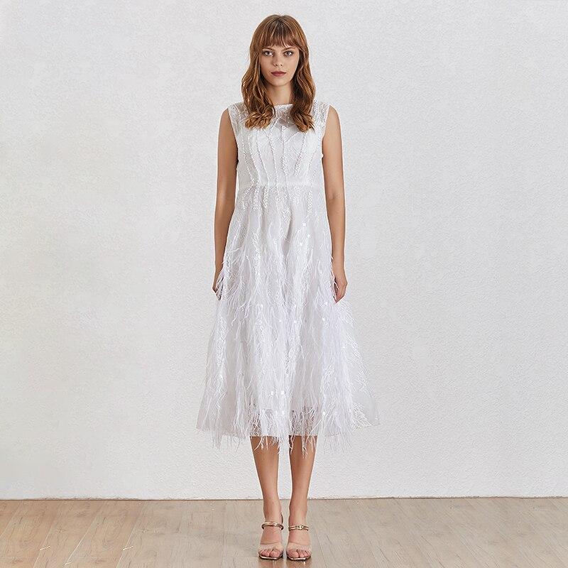 TWOTWINSTYLE 2019 moda nowy sukienka na imprezę kobiety O Neck bez rękawów pióra Backless Slim stałe Ball suknia wieczorowa kobiet lato w Suknie od Odzież damska na  Grupa 2