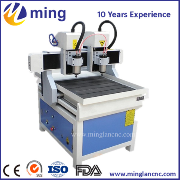 600mm*900mm*150mm tow spindle high accuracy adversting cnc router 6090 hot selling T-slot table 3d models mini cnc router rtm 6090 with t slot vacuum table