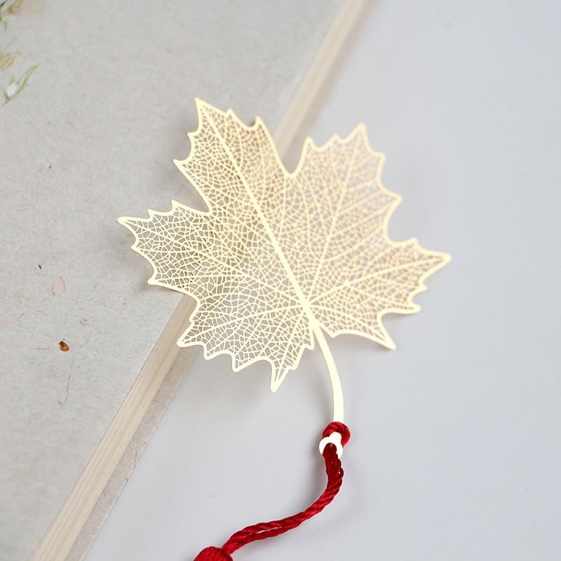 Купить с кэшбэком Cute Creative Golden Hollow Maple Leaf Metal Bookmark Stationery Bookmarks Book Clip Office Accessories School Supplies