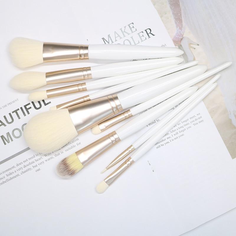 hzm nova moda feminina escovas 9 pcs pincel de maquiagem branco ferramentas de maquiagem po escova