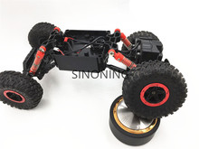 все цены на Rock Crawlers Driving Car Chassis 4WD Double Motors Drive Bigfoot  1:18 Model modify part robot car chassis SN170 онлайн