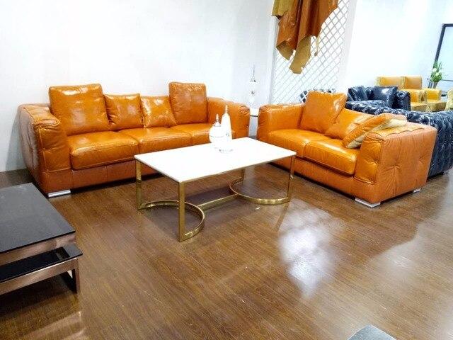 Cuero de grano superior sofá patas de acero inoxidable contemporáneo ...