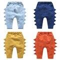 A nova primavera de malha das crianças calças de brim do bebê do bebê dinossauro estéreo Crianças calças Meninos calças 2017