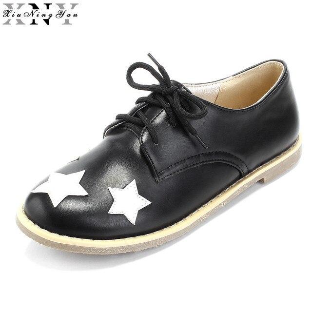 XIUNINGYAN Plat Chaussures Femme de Causalité En Cuir Chaussures Femmes  Célèbre Créateur De Mode Chaussures Marque c74ff705be08