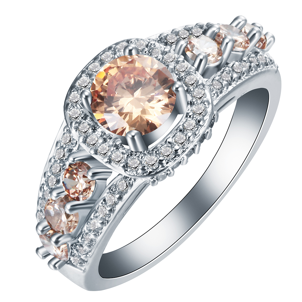 photo wedding rings in a bright orange flower orange wedding rings Stock Photo Wedding Rings in a bright orange flower