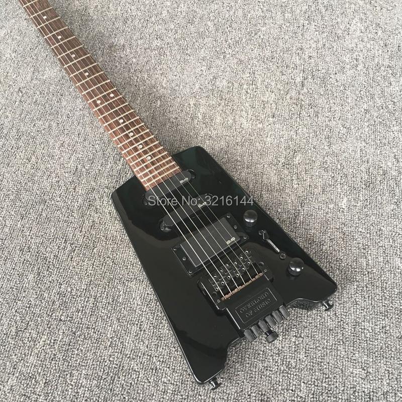 Voyage la nouvelle guitare électrique sans tête noire, guitare électrique, vente en gros d'usine, toutes les couleurs peuvent être, il peut personnaliser selon