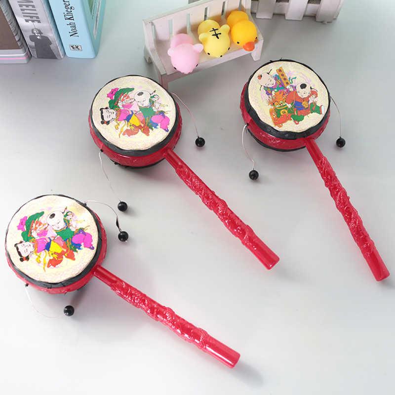 Bebek çocuk karikatür plastik el çan erken çocukluk müzikli oyuncak müzik aleti çin geleneksel çıngırak davul Spin eğlenceli oyuncaklar