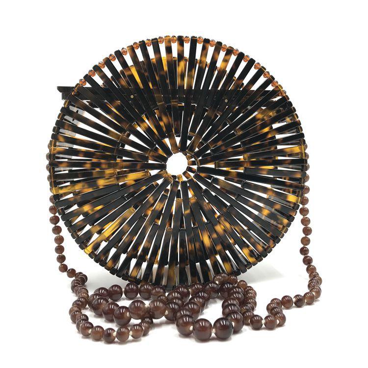 купить 2018 New European American Mini Rink Acrylic Round Hand Held Shoulder Bag Beach Holiday Hollow Out Bead Strap Circular Bag Moon онлайн