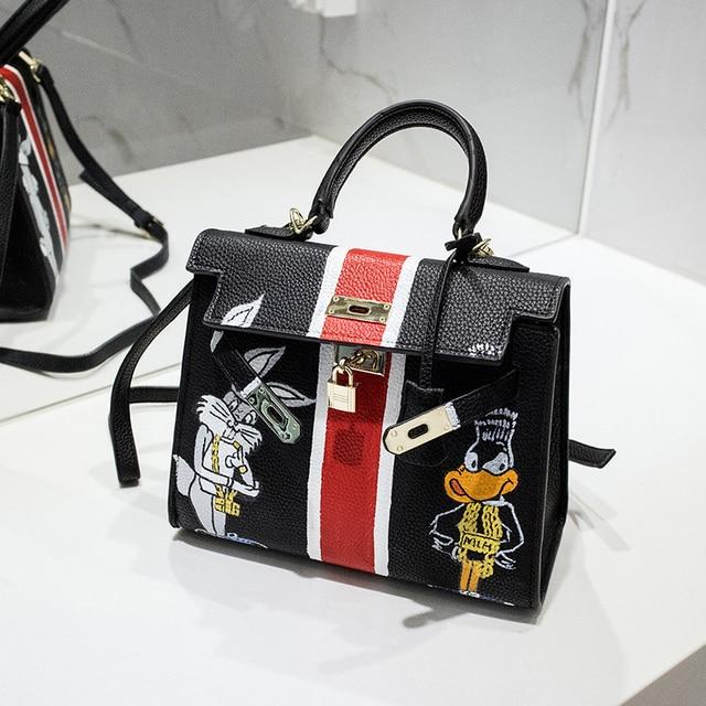 458ed92985 2016 High quality Luxury design Litchi grain spoof personality graffiti  handbag Hand-drawn cartoon Bugs bunny 28CM messenger bag