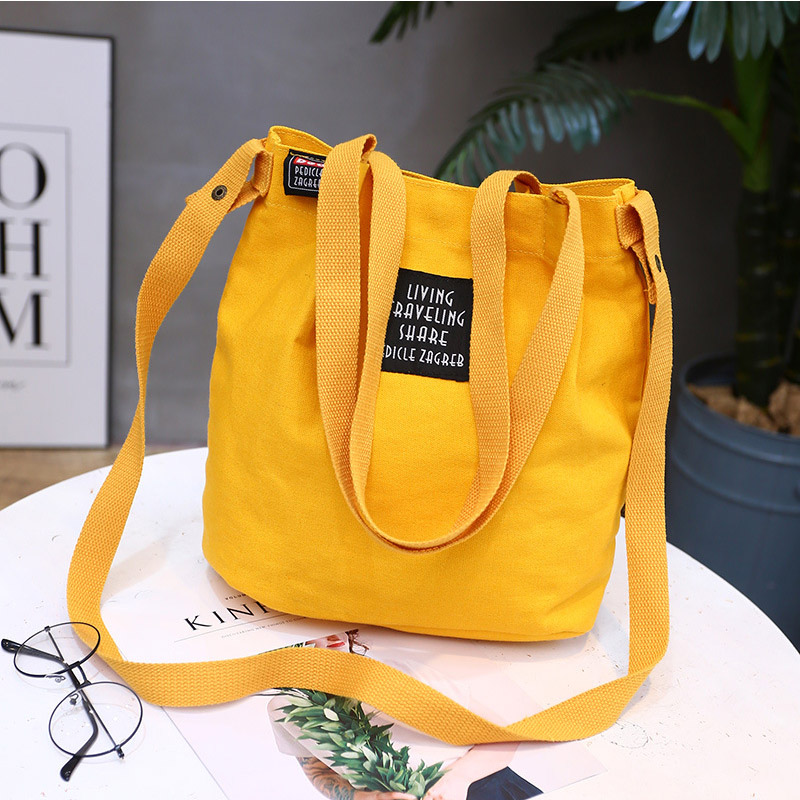 Handbag bucket bag single shoulder inclined simple canvas bag literary letters Japanese Mori lady bag in Top Handle Bags from Luggage Bags