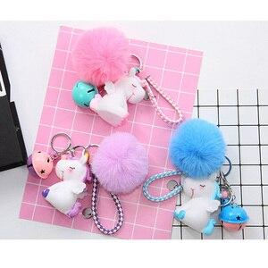 Image 1 - Unicorn karikatür sevimli anahtar toka yumuşak Hairball hayvan bebek çanta süsler kız en iyi hediyeler küçük çan benzersiz ucuz sevimli oyuncak
