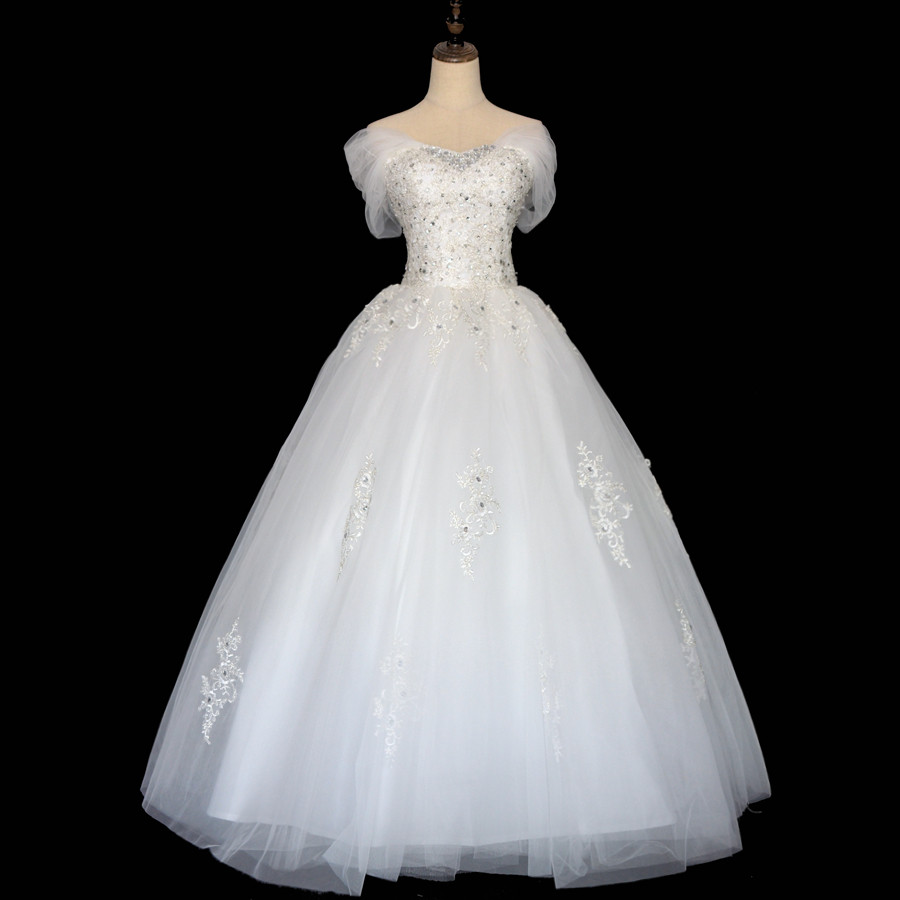 LOVSKYLINE Lace Wedding Dress 2018 Vestido De Noiva Custom Made Boat Neck Lace up Beaded Floor length cap sleeves