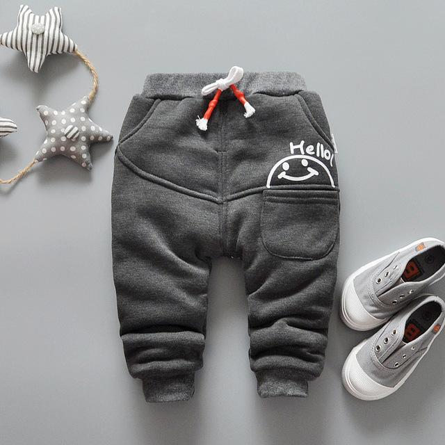 Nuevo invierno de los niños pantalones niños y niñas de moda engrosamiento pantalones de los niños pantalones casuales más efectivo