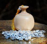 Beautiful ceramic tea caddy tea canisters + Gift 45g(about 80pcs) 2013 PuerChaGao(shen) chocolate shape teablock