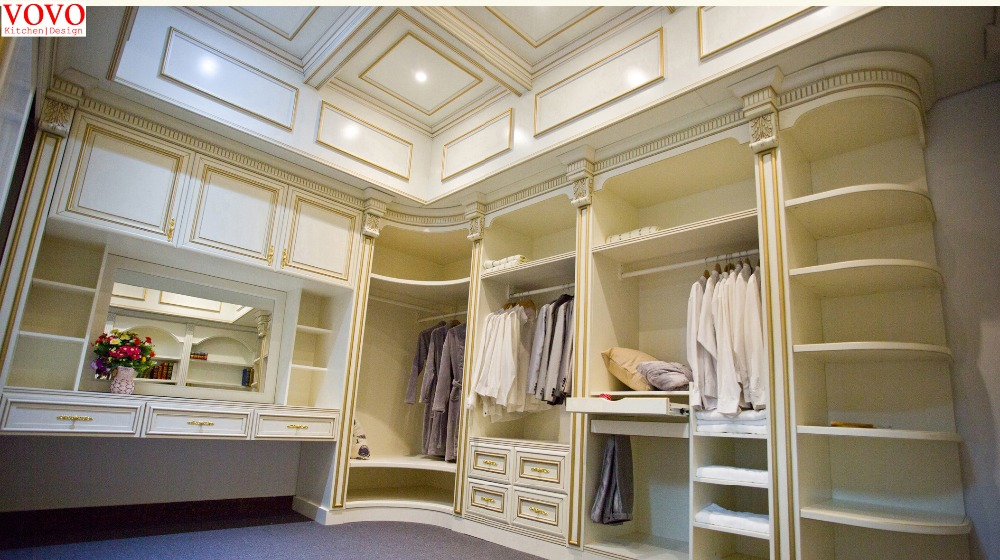 White walk in wardrobe with gold painted Roman column-in