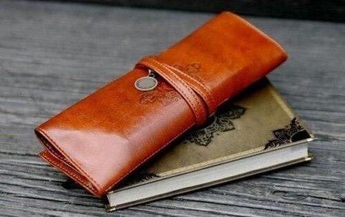Venta caliente 1 piezas de maquillaje brochas bolsa estuche de lápiz soporte rollo de papelería marrón cuero belleza portátil bolsas de maquillaje