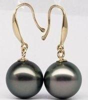elegant 10 11mm natural tahitian peacock green pearl earrings yellow gold