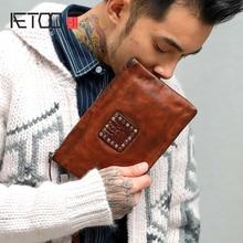 AETOO Retro head cowhide Zipper handbag Male Large capacity hand grip bag soft leather casual envelope tide