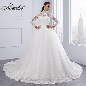 Image 1 - Miaoduo Vestido De Noiva Plus Size Hoge Hals Iiiusion Back Lange Mouwen Bruidsjurken 2020 Baljurk Trouwjurken Voor vrouwen