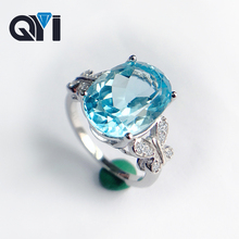 цены QYI 6 Ct Oval Cut Sky Blue Natural Topaz Luxury 925 Sterling Silver Engagement Women Gemstone Jewelry Fashion Butterfly Ring