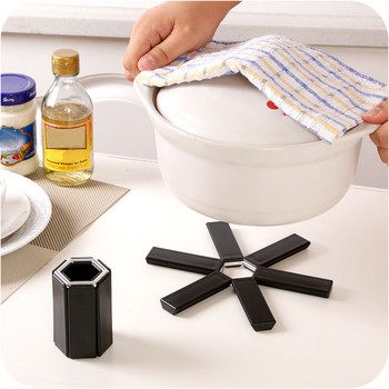 Foldable Black Trivet With Small Circular Hole Designed On Edge For Kitchen Use