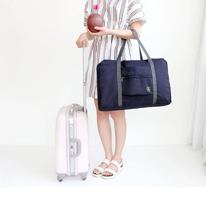Femmes Bagages Voyage Sacs À Main Nouvelle Mode Portable Grande Capacité Sac Femelle Nylon Imperméable Unisexe Pliant Sac Pochette de Voyage