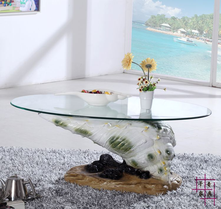 Conch tea table. The circular toughened glass small family sitting room tea table modern tempered glass tea table small room creative tea table in the living room