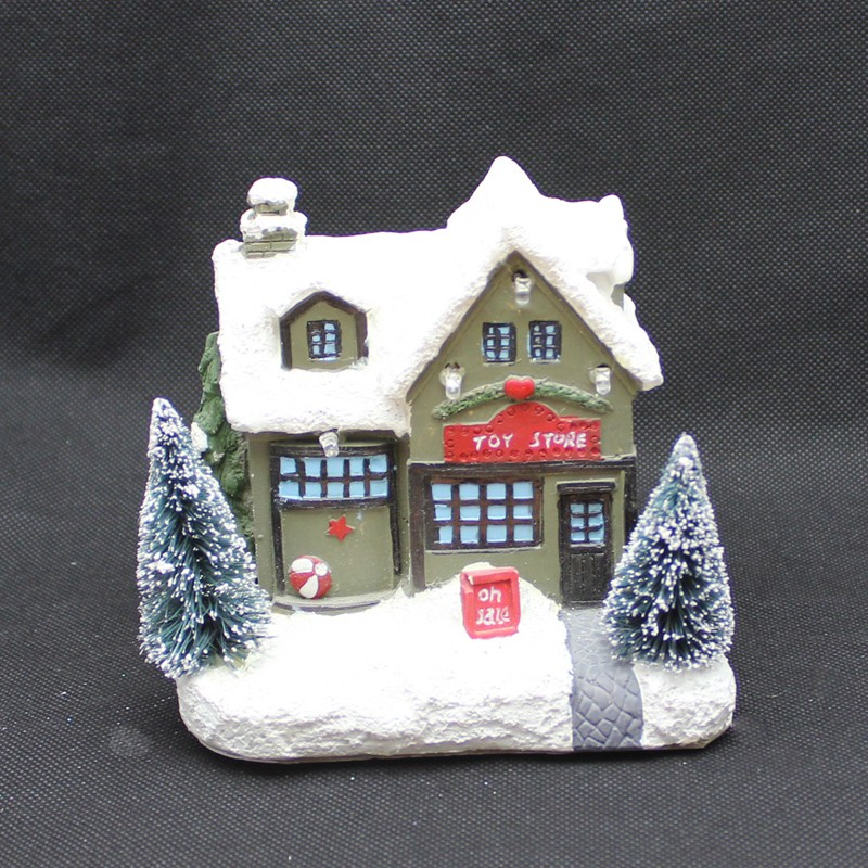Christmas house with tree and snow