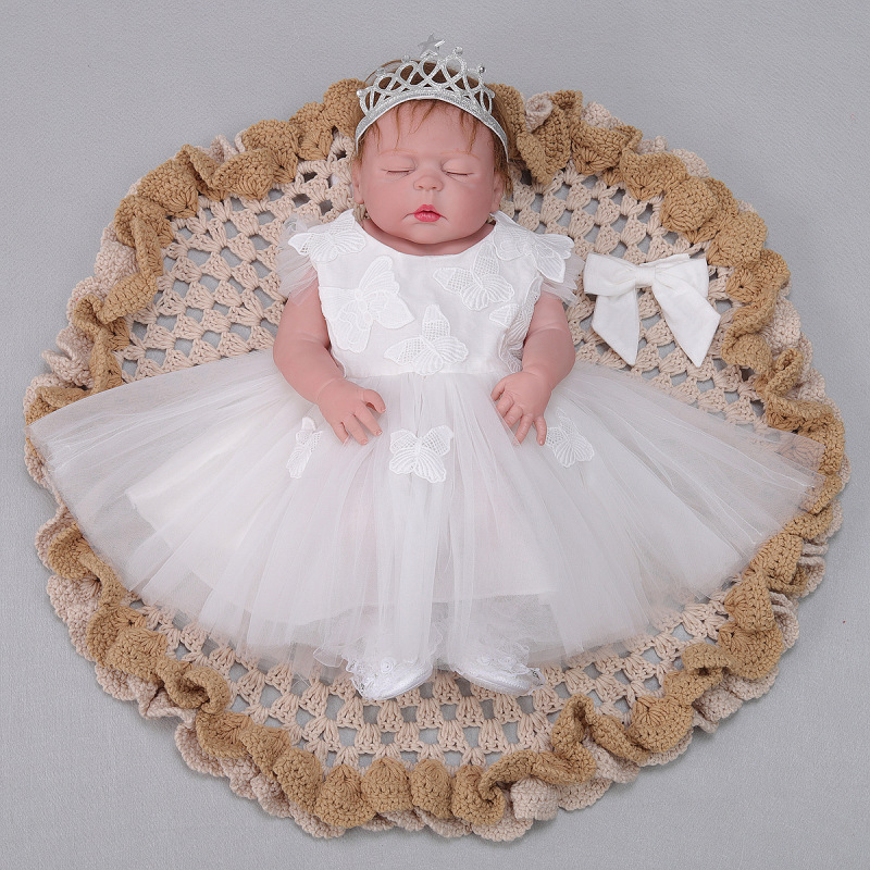 Bebes reborn princess girl doll 2255cm full silicone reborn baby dolls with whitle/purple dress newborn babies dolls gift Bebes reborn princess girl doll 2255cm full silicone reborn baby dolls with whitle/purple dress newborn babies dolls gift