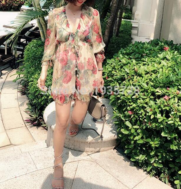 5855817040c9 2018 New Silk Taupe Floral Print Ruffle Melody Floating Playsuit With Deep V  Neckline & Full Blouson Sleeves Elasticated Waist