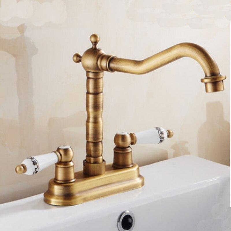 ФОТО Modern Antique Brass Swivel Bathroom Sink Faucet Mixer Dual Handles Deck Mounted