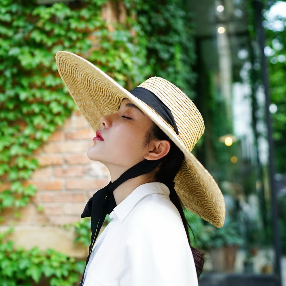 7473e87781a8f Aliexpress.com   Buy Summer Boater Hats for Women Wheat Straw Beach Hat  with Wide Brim Hat with Ribbon Tie 671073 from Reliable boater hat  suppliers on ...