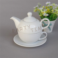 Ceramic tea set for one person, white tea pot and tea cup with a saucer
