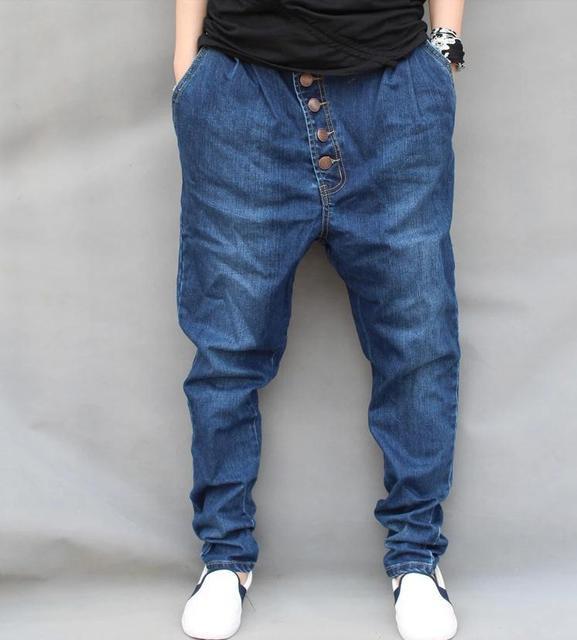 ecac44eab7 De los hombres de Hip hop Pantalones Vaqueros Flojos Del Harem pantalones  Holgados Cónicos Pantalones de