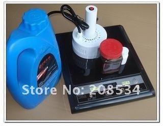 Máquina de envasado de sellado de botellas de papel de aluminio de sellado por inducción electromagnética de 220 V para barriles de aceite / miel / papel de aluminio