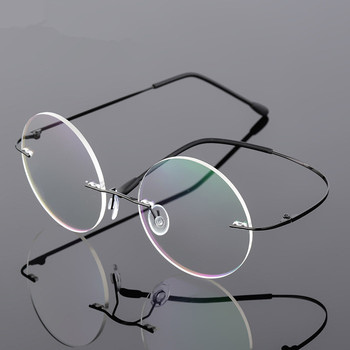 6107a92336 Steve Jobs estrella estilo plegable de la luz Ultra-Memoria de titanio sin  montura redonda miopía gafas óptica gafas de marco de los hombres gafas