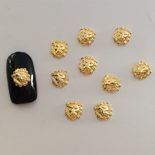 100pcs/bag 2015 New Charms Nail art Decoration DIY 3D Nail Accessories Metal Lion Nail Polish Sticker-in Rhinestones & Decorations from Beauty & ...