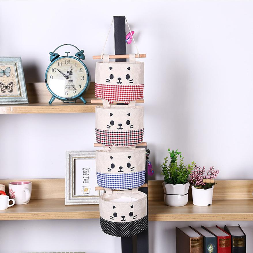 4e62276af8d1 US $1.29 35% OFF New Cotton Cartoon Cat Hanging Storage Bag Debris Pouch  Wall Combination Ideal For Storage Sundries and small item-in Storage Bags  ...